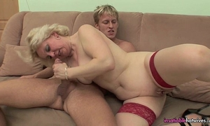 Mature in red sexy underware fucking her youthful man