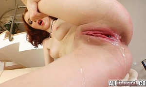 All interior redheaded receives her slit filled by two knobs
