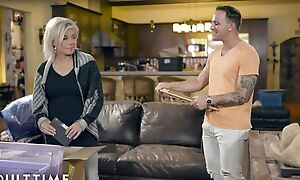 Blonde-haired mature pleases tattooed dude on leather couch